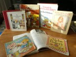 front row: Strawberry Shortcake, Childcraft, AlphaBakery - back row: Tasha Tudor's Christmas Book, Anne of Green Gables Cookbook, Ideals Junior Cookbook, Someone's in the Kitchen with Dennis, Kitchen Fun