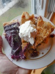 Thanksgiving Desserts: grape pie, pumpkin pie with whipped cream, and Indian Pudding
